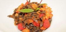 Home made black tagliolini with shrimps